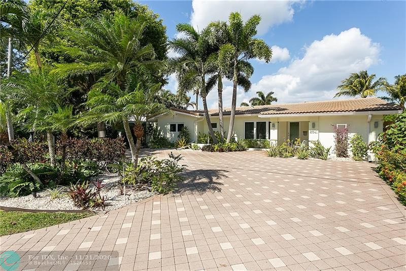 The ultimate sophisticated waterfront renovation offering comfortable spaces & entertaining perfection has arrived in E Wilton Manors. With 3BR /3BA, this stunner has bright open spaces flowing from front door through living/dining/family room (w/ blackout curtains) & out to amazing riverfront lounge, heated pool & dock spaces w/ peaceful river views. Porcelain floors & crown molding throughout. Gorgeous kitchen with tucked away outlets, dual gas ranges, huge island, abundant storage. Enormous laundry room that doubles as caterer's kitchen w/ tons of cabinets, separate sink, dishwasher + room for fridge or freezer. Master suite features elegant, modern bath w/ huge shower & standing tub, custom cabinetry w/ lighted mirrors & nicely outfitted WI closet. Storage shed. Whole house generator.