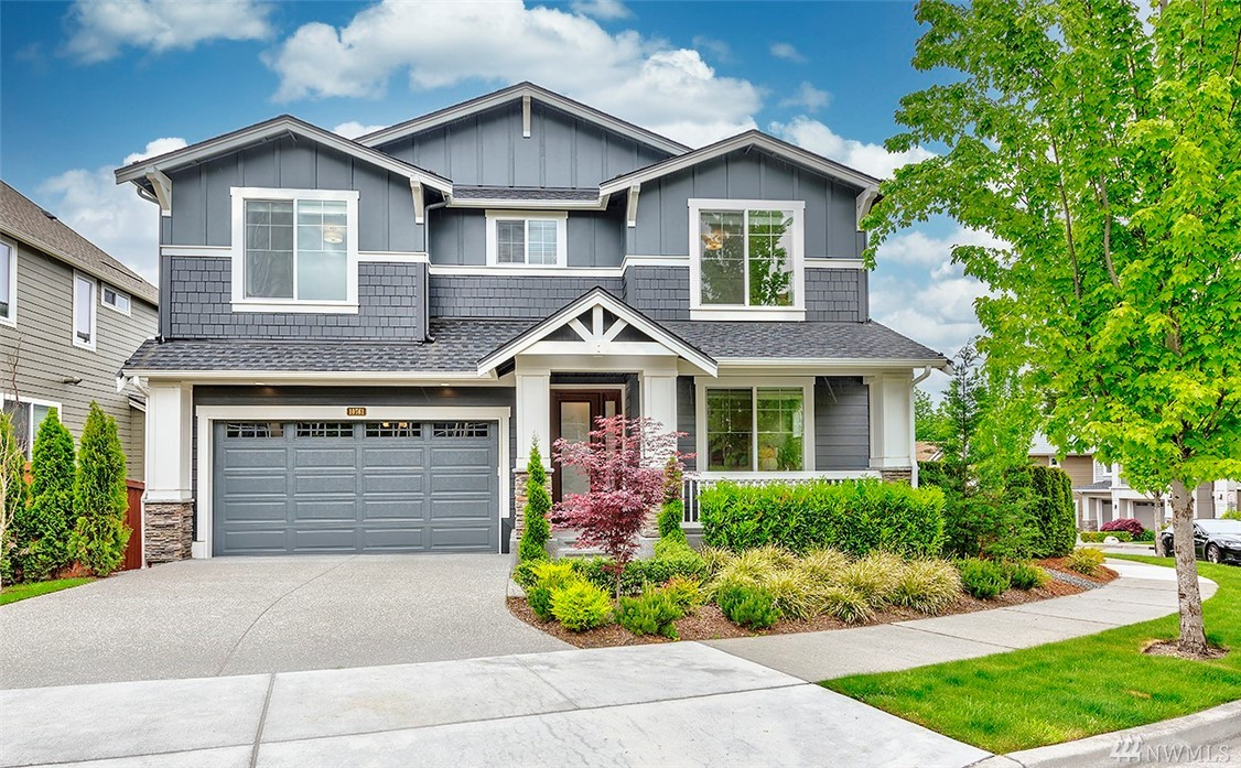 """2018 built resale home in Verona! This """"Hickory""""design by Murray Franklyn is custom-designed, features 4 beds, 3.5 baths, main floor den w/three-quarter bath, mudroom w/built-ins, huge daylight basement, walls of windows, gourmet kitchen w/quartz counters & commercial grade SS appliances, spacious master suite, sumptuous spa-like bath w/his & hers walk-in closets, covered deck w/ heaters & fully fenced backyard & East facing. Verona enjoys exclusive access via a path to the Burke-Gillman trail!"""