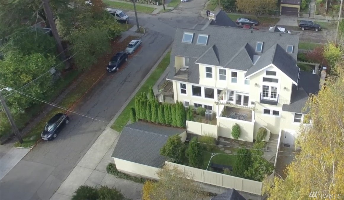 Born in 1892 and completely remodeled in 1997, this dutch colonial was refreshed in 2006 with smart features, luxurious finishes, extensive earthquake retrofitting, and energy efficient but powerful appliances & systems. Views of Cascades and Bellevue from every floor, Lake views from top 2 floors. Master includes large walk-in closet, opulent marble bath w/ ceiling mount tub filler. Plus MIL w/full bath/kitchen/laundry.  Only 2 blocks from fine dining, wine, ice cream, shopping, parks on 34th.