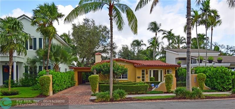 """Beautifully renovated Mediterranean Revival pool home in historic Rio Vista. A City of Ft. Lauderdale Community Appearance Award recipient, this is a home to be proud of. Enjoy a deep homesite that is professionally landscaped & fully fenced (fence-2018) for privacy. Live outdoors in your custom, free form pool & cool deck (pool & deck-2016). Too many features to list here: formal foyer with exposed wood beam ceilings, choice kitchen with select granite, 42"""" wood cabinetry, S/S appls, & extended buffets in dining & laundry rooms, renovated main bathroom, wood burning fireplace, restored terrazzo floors. Situated on a charming street with sidewalks. Stroll your prestigious neighborhood & explore a variety of architecture, visit parks, & see boats & wildlife. Located just south of Downtown"""