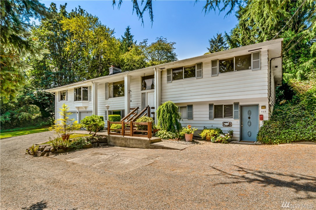 Large split close to everything Burien has to offer! One owner since 1984: very well maintained! Upstairs 4 beds 2.75 baths, Living room + family room/office. Downstairs can be a separate living space with 2nd kitchen, 2 bedrooms, rec room with fireplace & one bath.Huge lot (15,660 sq ft)with detached workshop w/kitchenette + bath - ready for your creative touches! Easy access to 509, parks, airport, freeways + shopping. Near Seahurst waterfront park + downtown Burien shops & pubs. Subdividable!