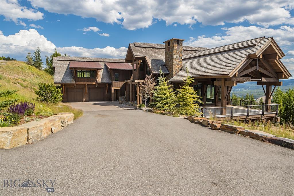 Located on the South slope of Andesite, this incredible home is a combination of Montana rustic & Montana contemporary with walnut floors, tongue-and-groove fir ceilings, floor to ceiling windows & a very cool floating staircase. The great room has a 20' dry-stack rock fireplace. The home sleeps up to 18 people with two master suites, bunk room, guest rooms & a recreation room with additional built in bunks. From the lower level family room walkout to a flagstone terrace where the swim spa is & swim against a current at two levels of speed! This home's infrastructure is cutting-edge with Cat 5 technology, a Lutron lighting system, in-floor radiant heat, & audio throughout the home & outdoor spaces. All just a few minutes drive to the heart of the Club amenities. Enjoy views to Cedar and Pioneer Mountains, the Gallatin Range and The Sphinx. This property is a wonderful place to spend quality time with family & friends while visiting & taking in all that the Big Sky area has to offer.