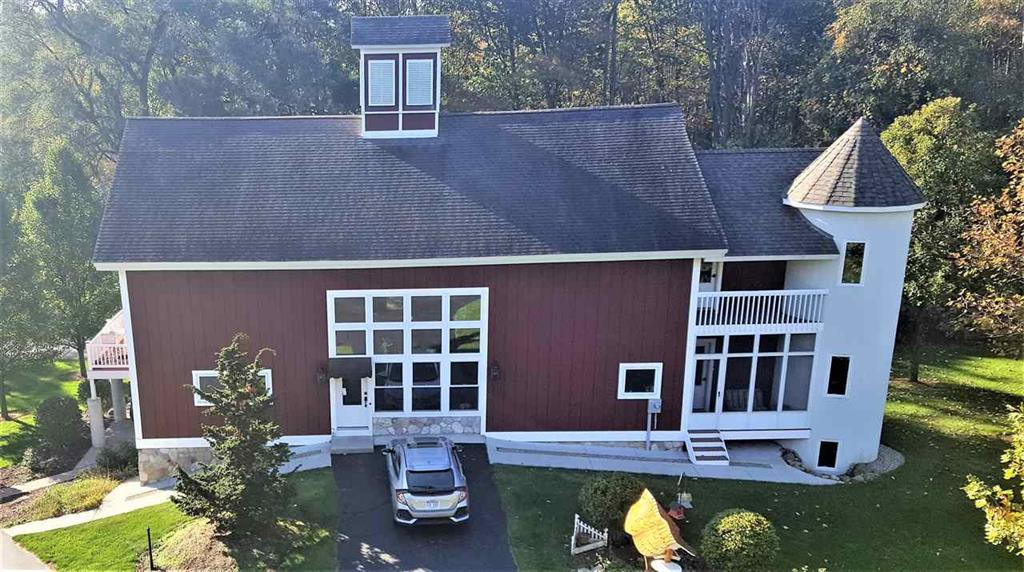 Fully custom converted barn home. Completed in 2006, the builder has carefully and thoughtfully restored character and elements while merging them with the modern-day touches. This spacious home, which sits on 3.94 acres, and, offers three bed rooms, a walk out basement, 3 car garage, 3 fire places, as well as second story lofts. In addition, this beautifully crafted home offers theater room, office space, music room in addition to a sewing room; all of which could be additional bedrooms if needed. The owners suite features vaulted ceilings, a jacuzzi tub, as well as walk-in closet space. The laundry is on the same level as the bedrooms. A beautiful porch/sunroom off the living room gives you a quiet space. The kitchen and dining are open to the second story and a large wall of windo