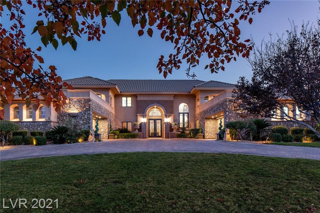 Beautiful custom estate home situated on over 1 acre. Located on one of the most desirable streets of the double guard gated community of Queensridge. The elegant  foyer entry welcomes you with a 10 ft crystal chandelier & a sweeping grand staircase. Luxurious formal living and dining room with majestic 21 ft tall ceilings and windows. The open concept family room overlooks the manicured backyard and sparkling pool. Fully equipped gourmet kitchen. Master bedroom suite includes 2 large walk-in closet, exercise enclave, and a 800 sq ft viewing deck. Enjoy a finished elevator and a climate controlled wine room. Spacious backyard with multiple dining, sunning, & entertainment areas.