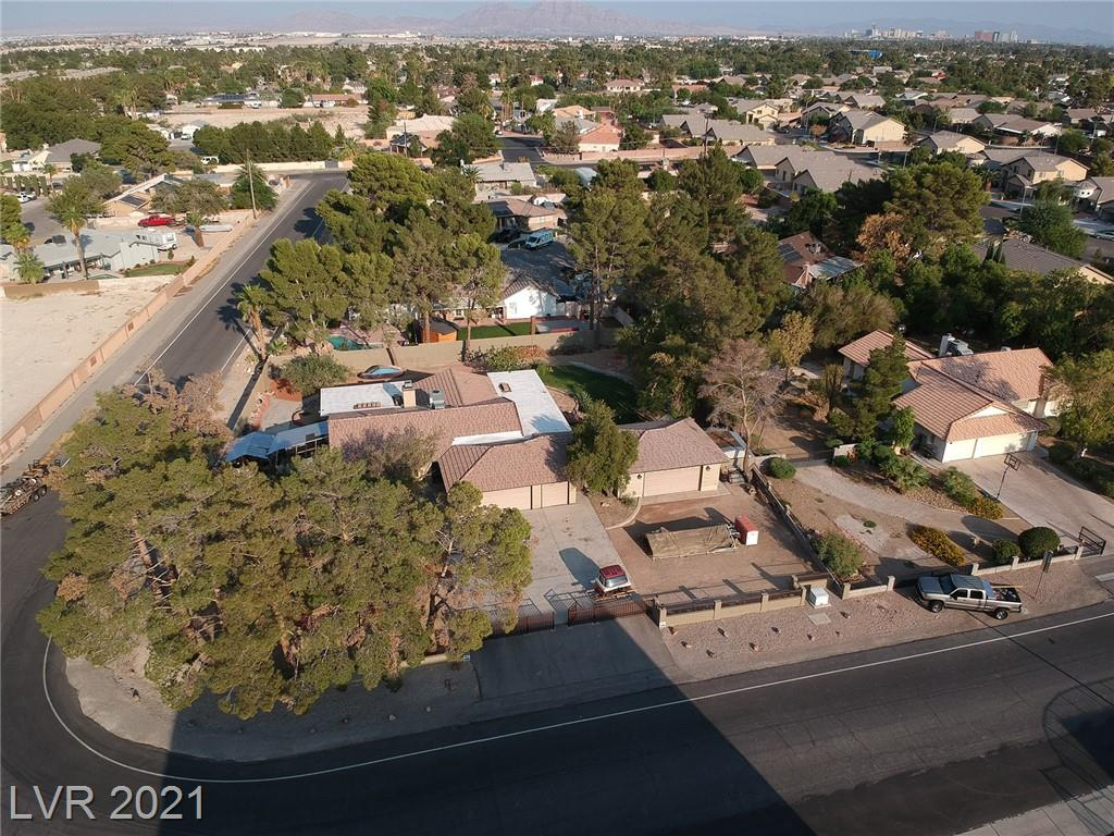 Make your dream a reality with this beautiful ranch style home in the Northwest!! 5 Car Garage, NO HOA and over 1/2 acre lot with xeriscaped front yard with mature pines & landscaping to welcome you. It is the last house on an inter-neighborhood street that has little traffic. The stunning zen like backyard has a walking path, deck area, a shop area, built-in shed with large spacious area for parking and a large RV gate on north side. A built -in firepit, streamed with lighting is the perfect spot for relaxing and entertaining. 2880 Mustang is an entertainers paradise and has hosted many weddings. One of the two car garages is a to die for home theater. You are welcomed into this 3Bdrm home with a custom designed kitchen including a commercial Wolf stove & granite countertops. The living room is adorned with a wood burning fireplace, vaulted ceilings and double doors to the back patio. The maintenance and care given to this home is impeccable. Don't miss this ultra rare opportunity!!