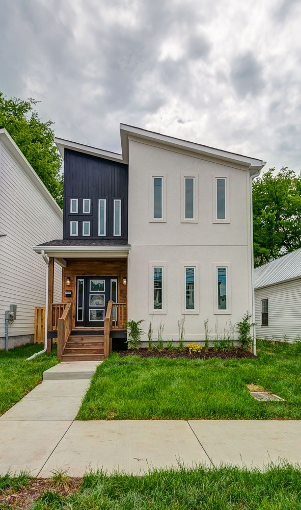 Stunning modern new build close to FARMER'S MARKET, DOWNTOWN, and GERMANTOWN. Location and design make this gorgeous home a must-see. Alley access parking pad and GARAGE!
