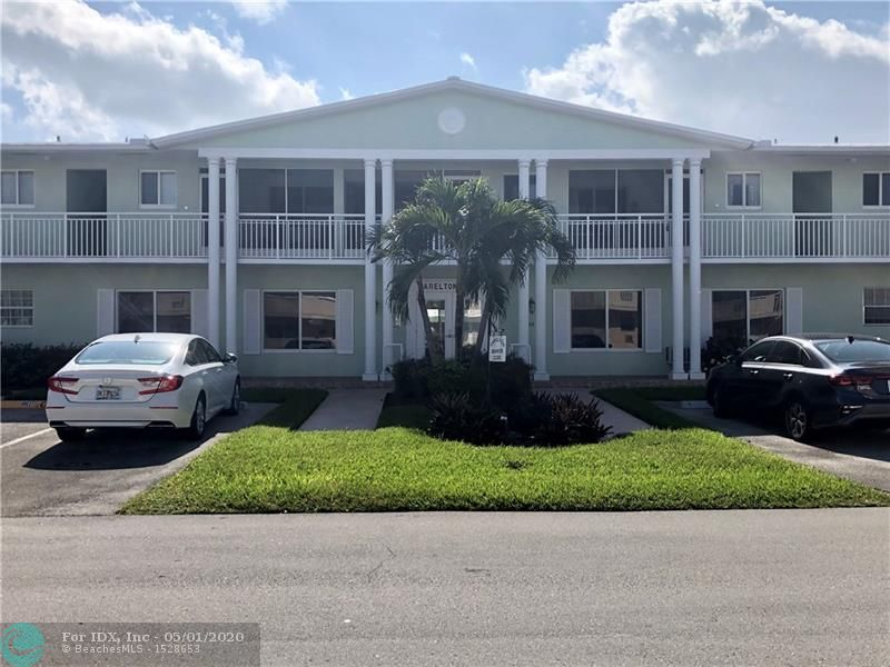 Wonderful opportunity to put your own stamp on this tucked away gem! Unit is being sold AS IS; it has beautiful marble floors throughout the unit, with two updated bathrooms. 55+ community with a pool, laundry room, club room and dedicated parking space. Minutes from Hillsboro Inlet, Deerfield Beach, close to shopping, restaurants and Publix.   No Leasing for 5 years.