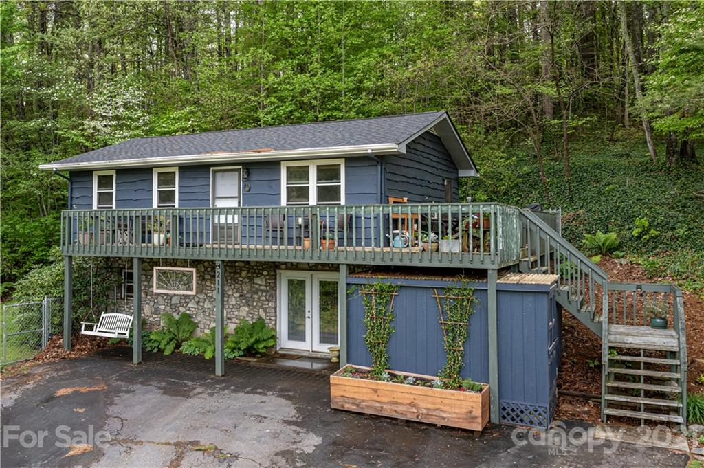 Come check out this slice of mountain paradise! Located a few minutes from downtown Weaverville, and 15 minutes from Asheville, this home has so much to offer! Recent upgrades include a newly remodeled kitchen with all new appliances, a new roof, and a new water heater. The space is tasteful, meticulously maintained, and so much wonderful outdoor space to enjoy. The wrap-around porch has views for days, and the location couldn't be better for access to all the Weaverville, Asheville and surrounding areas has to offer. With ample garden space, plenty of storage, and a great layout, this is one you can't afford to miss!
