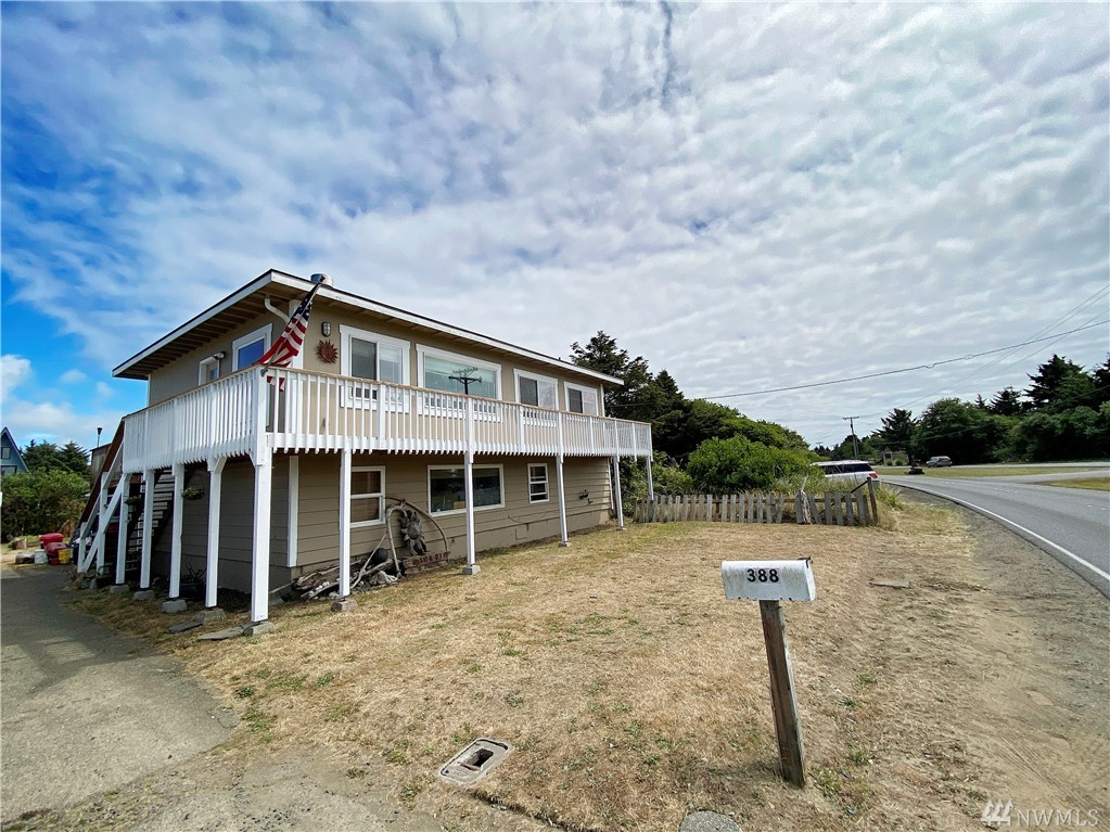 Awesome classic ocean shores home in good condition across the street from a local beach access. This great home has a lot of windows and an open living area with a big partially fenced backyard. Out back you will find a great upstairs deck overlooking the property. This house has plenty of space with three large bedrooms. Bonus room downstairs and an outdoor covered space. Property is also close to downtown with all the fun activities and restaurants. Remodeled in 2017.