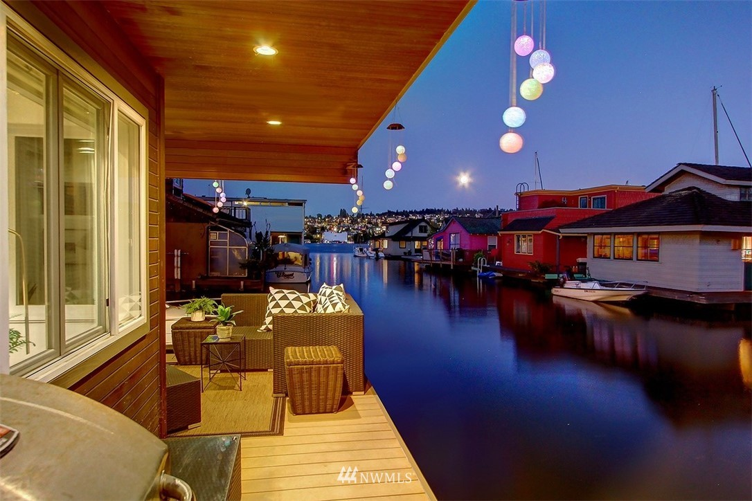 Lake Union reflects into this spectacular 3-story floating home w/full underwater floor. Boundless Seattle skyline & water views on rooftop deck. Plenty of moorage (2 slips) – get on your boat and go! Blue Mediterranean inspired rooftop tiles. Chef-friendly open epicurean kitchen. Bamboo flooring on main, radiant heat flooring throughout. 3 bds – one includes deck & gas fireplace. 2 baths – one w/jetted deep tub, sauna. Swim, paddle, ponder on the water; it's not just a home, it's a lifestyle.