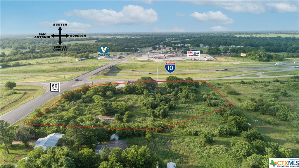 4.57 Acre corner development site with existing 1,708 sq ft structure in place that can be utilized if desired. Located at one of two Luling exists off IH-10 which allows commuters to quickly reach other major highways like US-183, US-90, TX-80, and SH 130 Toll. Direct access, excellent signage visibility, and strong traffic counts on the main thoroughfare from Houston to San Antonio. Corner lot includes three existing curb cut driveway entrances. Approximately 410' frontage along Highway 80. Approximately 453' frontage along IH-10 access road. Great site for commercial use, mixed use, or hold it for future development. Property will be restricted against uses competitive with convenience stores.