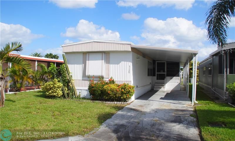 CHARMING & READY TO MOVE IN 2 BED 2 BATH MANUFACTURED HOME LOCATED IN RAVENSWOOD ESTATES WHERE YOU OWN THE LAND...!!! THIS HOUSE FEATURES: A NICE OPEN KITCHEN W/NEW WHITE CABINETS AND OPEN FLOOR PLAN TO DINING AND LIVING ROOM. NICE SCREENED-IN PORCH ON CERAMIC FLOOR RIGHT OUTSIDE THE KITCHEN FOR DINING OUTSIDE..!!  SPLIT BEDROOM PLAN WITH EACH PRIVATE BATHROOMS. WOOD FLOORS. NICE CARPORT AND ROOM FOR 3 CARS. SHED WITH NEWER WASHER & DRYER.  ALL FURNISHED, BBQ, DISHES, LINENS, ETC. AND READY TO MOVE IN...!!! THE COMMUNITY OFFERS: OLYMPIC SIZE SWIMMING POOL, TENNIS, ACTIVITIES & MORE..!!   CLOSE TO SHOPPING, HARD ROCK CASINO, 4 MILES FROM THE BEACH AND GREAT RESTAURANTS...!!!  LOW MAINTENANCE...!!! DON'T DELAY, SCHEDULE YOUR PRIVATE VIEWING TODAY...!!
