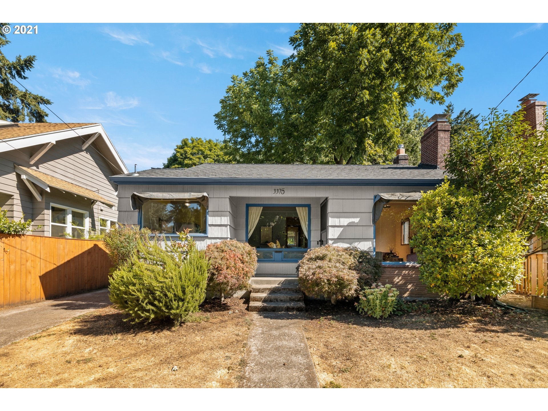 When location matters, you can't pass on being in the heart of the Wilshire & Alameda area! This little jewel really shines with superb blend of hardwoods + mahogany; a sunny kitchen w/ tiled floors & stainless appliances; excellent storage and bonus space in LL that could be used for guests, work, or that extra lounging space we all need. Mature landscaping in fully-fenced yard and raised garden bed takes advantage of southern light for growing.  Please see list of upgrades to systems, etc. [Home Energy Score = 7. HES Report at https://rpt.greenbuildingregistry.com/hes/OR10193427]