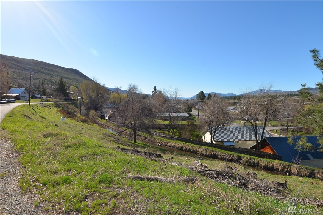 Wonderful View Lot in Winthrop! Convenient in town location in the highly desirable Heckendorn neighborhood. Water/power/sewer are in the road. Quiet road. Building site has excellent sun exposure. This one won't last long.