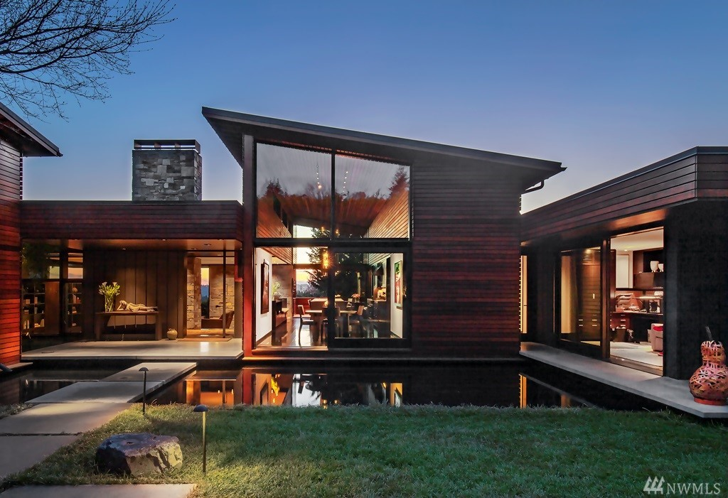 Spectacular AIA award-winning NW contemporary. Brilliant design by noted architect,Rex Hohlbein,blurs the distinction between inside & out by connecting with landscape,natural light & expansive views thru walls of windows that fully open. Centric Chef kitchen w/LaCanche range,16-foot island & multiple seating areas,perfect for entertaining.Serene master with spa bath opens to pond & babbling brook. Office, bonus rm ,multiple entertainment terraces. Dramatic. Sophisticated. Unprecedented quality.