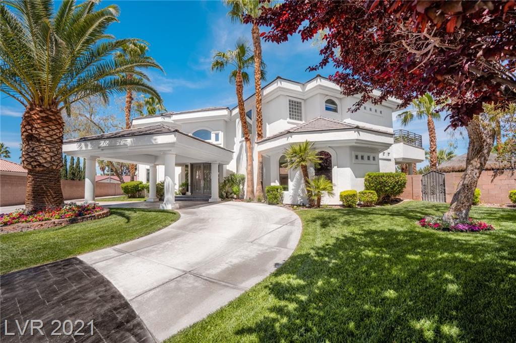 """Introducing The Opportunity to Live in Luxury w/ this Extensive Designer Renovation! This 2-Story Residence is Tastefully Upgraded to Look & Feel Like a Showcase Home. Located in Section 10 this 5,696 SQFT Home Sits on a .48 Acre Lot w/ Full Vegas Strip Views! The Grand Entrance Welcomes you w/ Towering 24"""" Ceilings, Limestone & Harwood Flooring & Floating Staircase. The Formal Living has a Floor to Ceiling Fireplace w/ Italian Quartzite Tile, Motorized Window Shades & Wet Bar w/ Grey Quartzite Countertop. In the Kitchen, Find Brazilian Granite & Quartzite Counters, Solid Wood Cabinets w/ Duotone Lacquer, SS Commercial Viking Double Oven w/ 6 Burner Cooktop & Sub-Zero Fridge. The Backyard Boasts a Tropical Lagoon Pool, Waterfall, & Pebble Tech Beach Entry. Entertain w/ an Outdoor Kitchen Including All Viking Appliances, Ice Maker, 60"""" Grill, Searing Grill, Chiller, Beer Tap & Fridge! Noteworthy Highlights: 4 York AC Units, Recently Replaced Roof, 3-Car Garage, New Washer/Dryer & More!"""