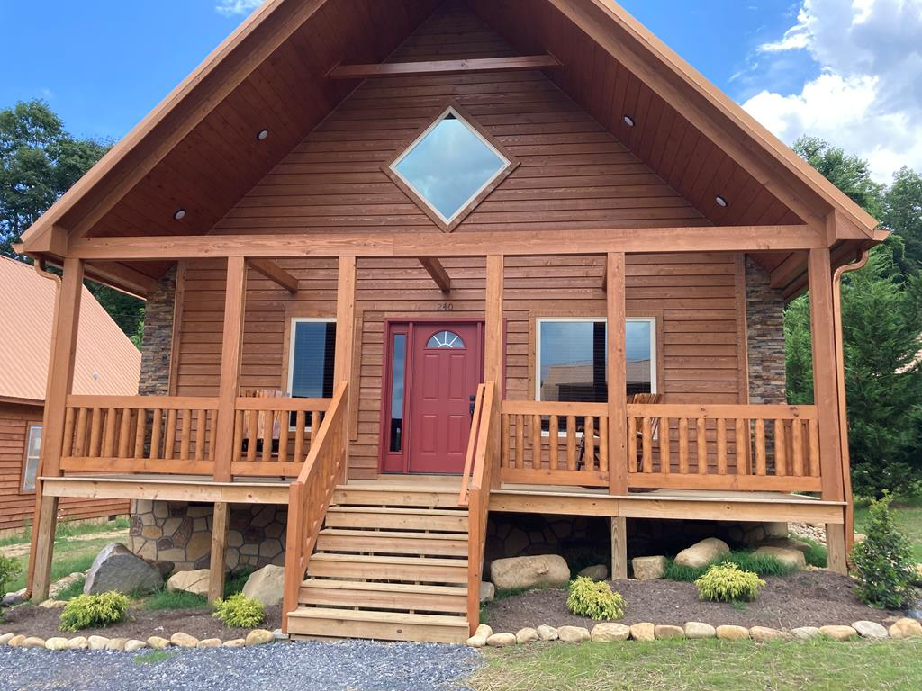 This brand new cabin is located in the pristine White Oak Lodge and Resort that touches the  Great Smoky Mountain National Park and is just  minutes to down town Gatlinburg.  Entering the cabin you will notice the open floor plan starting with the vaulted ceiling in the living room and kitchen. Wood floors throughout, flat screen tv, rock fireplace  The fully equipped kitchen includes upgraded finger proof high end appliances.  The master bedroom has a king sized bed, dresser, TV, private master bath and access to the back porch. The second bedroom has two double bunks, dresser, TV, private bath and also has access to the back porch.  Washer & Dryer are conveniently located in the laundry closet.  The back screened in porch includes an oversized hot tub, table and chairs.  Up the stairs you will find an open loft with two single beds, private bath and private screened balcony.