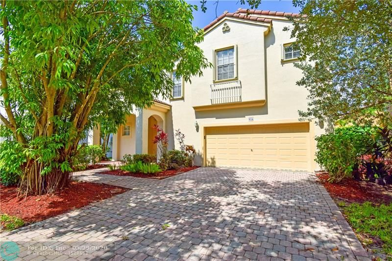 """Mediterranean Revival home in sought-after, gated neighborhood of Vizcaya. Too many features to list here: newly painted interior & exterior, volume ceilings, custom kitchen w granite cntps, 42"""" cabinets with ext in casual dining room & built-in desk, S/S appl, recessed lighting, & large pantry, updated master bathroom, tile & wood laminate flooring throughout, large garage, all hurricane protection (accordion upstairs), etc. Good condition; move right in. Well built; low insurance. Quick walk to amenities & guest parking. HOA includes lawn care, basic cable, alarm mon, gym, tennis... Convenient location with easy highway access. Close to everything: shopping, restaurants, parks, etc. Easily connect to Turnpike or I-75. Beach is less than 30 mins away. Excellent location & good schools!"""