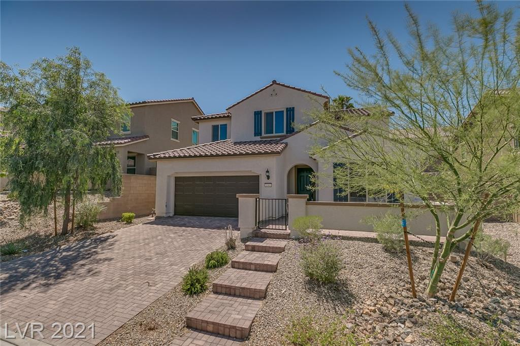A true gem in a crazy market. Beautiful and large 2 story nestled in the foothills of Henderson. The neighborhood features easy access to walking and biking paths just steps off the front porch/patio. The community has a great park featuring a small playground and walkways. The inside is an oasis of space with abundant natural light and tons of space to live. The upstairs has 3 separate bedrooms and a large loft. Downstairs features another full bedroom and bathroom, as well as a front den, large kitchen island, dining area, living room, and covered patio backyard.