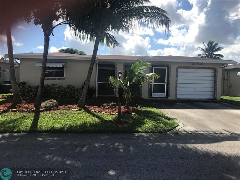 Large  2/2 home with garage and huge family room. Roof replaced 2014, A/c replaced 2013, new master bath in 2014.  New water heater in 2018. Maintenance includes lawn service and painting of the home every 5 years. basic cable .pest fertilizing. Community pool ,billiards, exercise room ,jacuzzi for 365. per quarter.  Located off  Military Trail  and north of sample rd. Close to major highways. Thanks for showing!