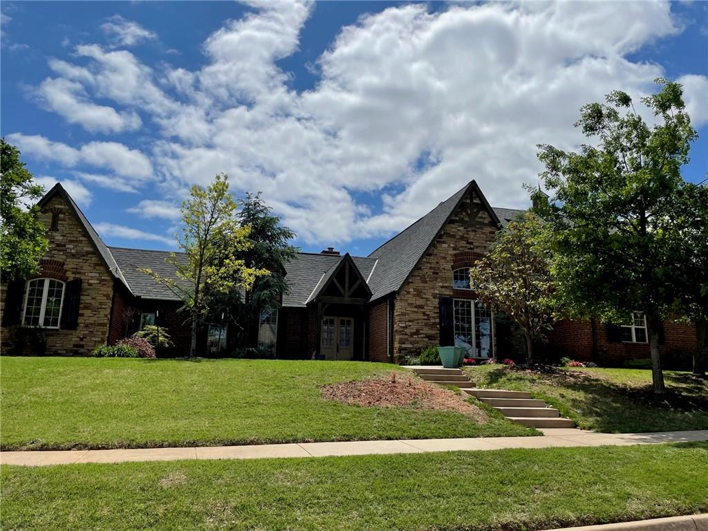 Stunning Old World Design home w/spacious living areas, open kitchen & dining, sitting area w/fireplace in dining room, granite countertops, built-ins, large primary bedroom w/his & her closets. This home is a MUST see!