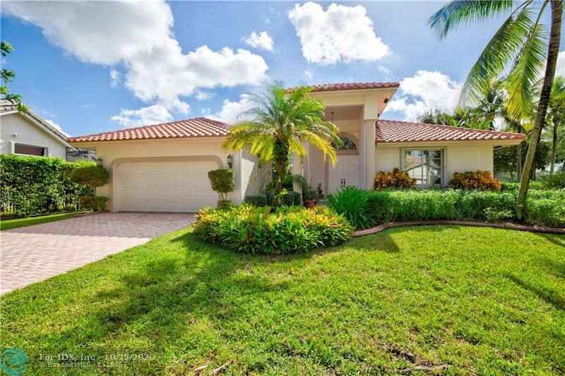 Enjoy the country club lifestyle in South Florida's premier community, Weston Hills!  Beautiful 5BD/3BA split floor plan home w/gorgeous curb appeal, over 12,000 SQFT private fenced & hedged corner lot w/POOL & covered screened patio, perfect for year-round entertaining.    Freshly painted outside, hurricane rated garage door, pool was recently diamond bighted, new water heater,  and NEW ROOF.   this light, airy home has a spacious 3-split floor plan & cabana bath.  huge master Suite has Marble floors, Jacuzzi, two vanities and a separate shower.  open kitchen that overlooks a huge family room.  too many great features to list.     Golf around the corner! A+ schools! This gorgeous home is in pristine condition... schedule a showing today!