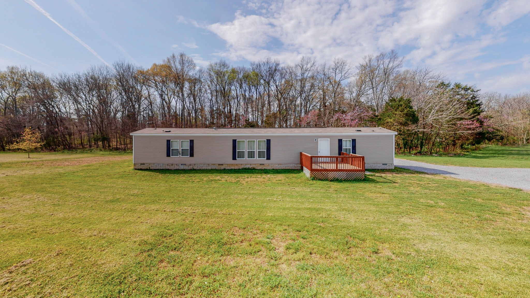 3 bed/2 bath Mobile Home built in 2017 sitting on permanent foundation ,5.6 acres tract in growing Rutherford County. Covered back deck...storage building and all appliances to remain......467 ft. road frontage...many options here...Buyers agent to verify  all info