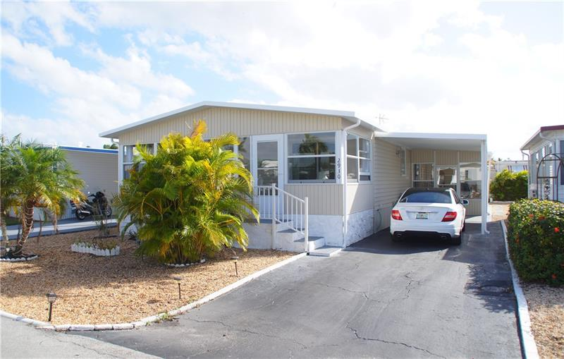 ***CASH ONLY*** JUST BRING YOUR TOOTHBRUSH...!!! VERY LARGE 2/2 MANUFACTURED HOME LOCATED IN THE PRESTIGIOUS ESTATES OF FORT LAUDERDALE WHERE YOU OWN THE LAND...!!! OPEN KITCHEN W/COUNTER & STOOLS. LARGE PANTRY AND LOTS OF STORAGE. 2 VERY NICE GLASSED ENCLOSED FLORIDA ROOMS. THE COMMUNITY OFFERS OLYMPIC SIZE SWIMMING POOL, SAUNA, GYM, GOLF, BOWLING ALLEY, LOTS OF ACTIVITIES AND MORE..!!  CLOSE TO SHOPPING, HARD ROCK CASINO, 4 MILES FROM THE BEACH AND GREAT RESTAURANTS...!!!  VERY LOW MAINTENANCE...!!! SCHEDULE YOUR PRIVATE VIEWING TODAY...!!!