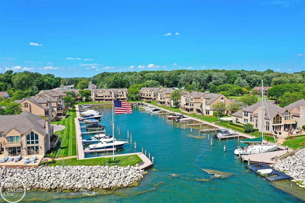 Welcome to lake life! Breathtaking updated condo in a gated community with a 50? boat slip. Stunning entryway w/marble flooring, new carpet going upstairs, & triple skylights for loads of natural light. All new porcelain tile on the 2nd floor w/stunning views of the water from your 3 door walls. Large great room with wet bar in between great room & den/office or game room. Bar area with built in beverage cooler, ice maker, cherry cabinets, granite counters, den with Brazilian cherry floors, plantation shutters, & recessed lights. Great room has ledgerstone gas fireplace w/quartz mantle & hearth. Entertainer?s dream kitchen with loads of Kraftsmaid dove tail cabinets, all new high end Kitchenaid s/s appliances including a hood fan with heat lamps, recessed lights, pull out shelves & breakfast bar area. 2 large bedrooms upstairs, master overlooking the water with enormous walk in closet and private bath w/jacuzzi tub & shower, double vanities & loads of cabinets.