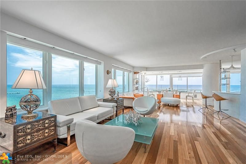 A spectacular panoramic view of the ocean and Lauderdale by the Sea greet you as you enter this 2 Bedroom Penthouse Unit!  Elegant wood floors and the open floor plan make this an ideal spot for tranquil reflection or entertaining friends and family. The Fountainhead Building has maintained its status as a unique luxury condominium residence.  24-hour security staff and valet greet you as you pull into the covered parking area. A private restaurant and lounge is open to residents Wed thru Sunday. The pool deck is approximately one acre with direct access to the beach. On-site management with 30 employees maintain Fountainhead's high standards. The building has passed the 40-year inspection process. This is a 55 and older residence.  No pets except service animals.
