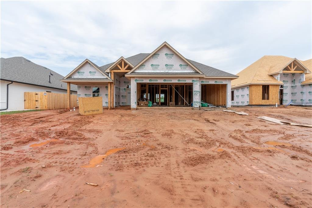 You won't want to miss out on your chance to own this beautiful New Construction home in Norman! This open floor-plan is sure to give you all the space you could ask for. The living room showcases a corner fireplace and large window allowing natural light to flood the room. Work remotely with the in-home study. Spacious primary bedroom is complete with a private en-suite including a double vanity, soaking tub, walk in shower, and walk in closet. Relax under the covered patio in the sprawling backyard. A wood fence is included up to the back corners of the home with one gate. Enjoy the neighborhood fishing pond! This home is a must see!