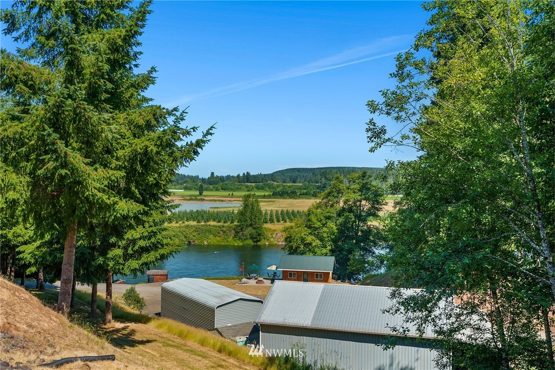 """Paradise on the River.  4.4 Acres on the Cowlitz River.  1700+ Sq Ft Mobile Home built in 1966. Fishing Shack, River Shelter, Lodge, 1920 Sq. Ft. Shop w/Loft, Meat/Fish Processing Shed, Outdoor Fish Cleaning Station, Road all the way to rivers edge, Carport/Garage, Pond, Three 30 amp RV Hookups Apple, Cherry, Pear, and Plum trees...  1.8 acres of property is subdivided with power and water, . Watch the Bald Eagles and Osprey fish on the river.  This is a """"Once in a Lifetime"""" property, and an Anglers dream  ...  don't let this one get away  ...  properties like this are RARE."""
