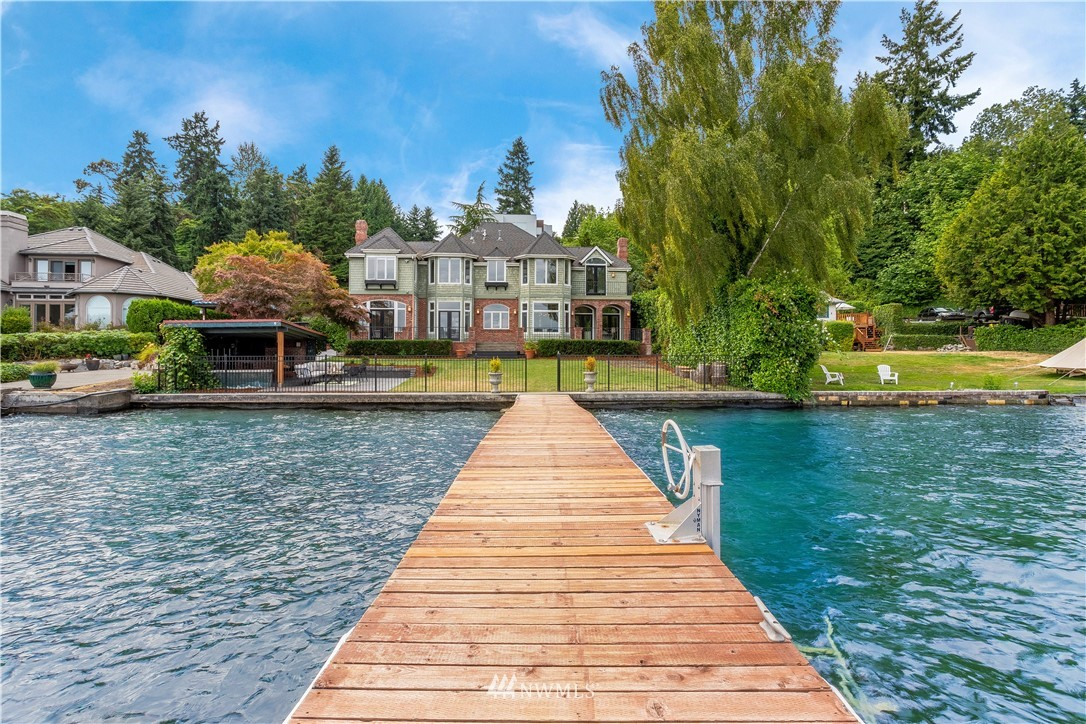 Enjoy the sunrise on the 80' waterfront with dock that sports a boat lift and views of Mt. Rainier and Lake Washington. Immersed in tradition, this 2 story house features all the comfort has to offer. Dramatic characteristics of the formal dining & parlor greets you. Attractive kitchen opens to the relaxed family room. The generous Master Suite includes a flex room. Second floor also includes a Guest Suite with a kitchen and full bath with its own access. Views from every room facing East. Main floor den/office can be the 5th bedroom. Deck and patio add to the beach vibe and outdoor entertaining. Ideal location close to the freeway offers easy access to Bellevue and Seattle. Don't wait to enjoy this Summer on the lake!