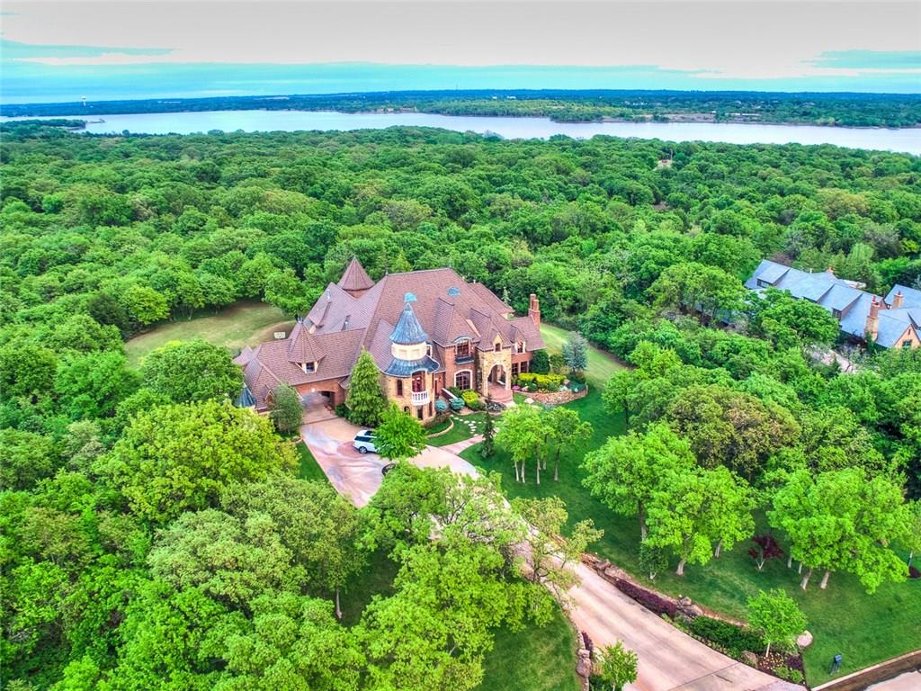 This remarkable Edmond luxury home exudes historic & classic European warmth. Situated on almost 2.6 acres on a quiet and wooded culdesac, this unique property boasts a beautiful and private setting. The home is masterfully and thoughtfully designed, meticulously maintained by original owner, with painstaking attention-to-detail in every aspect: design, layout, finishes, architectural details, landscape, storage,etc. Luxury and sophistication combine with today's amenities providing for an incredible living experience. The spacious interior has an elegant floor plan suitable for everyday living and frequent entertaining. Featuring a 3 STORY OBSERVATION TOWER with views of Arcadia,CAVINESS POOL AND LANDSCAPING,home theater,exercise room,wine cellar,game room,bar areas, safe room,2 utility rooms,bedroom suites,outdoor living, etc. Located near 15th & I-35 and only 20 minutes from downtown OKC. Have your boat unloaded on Lake Arcadia in under 10 minutes from this beautiful luxury home.