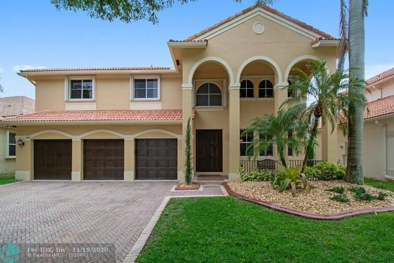 This beautiful 5 bedroom 4 bath is in truly immaculate condition. Pride of ownership, is ready to move in. Formal living and dining room + a huge family room. Among many features this elegant open floor plan offers a media room downstairs that can be converted into a 6th bedroom. Full bathroom downstairs. Spacious kitchen with granite countertop and stainless steel appliances. Master suite has a separate den/office. Walk-in closets custom made. 3 bathrooms beautifully remodeled. Covered patio and heated pool and spa are ready for your enjoyment and entertainment. Accordian shutters, 3 car garage. Guard gated community with pool, playgrounds and plenty of outdoor areas for the family.