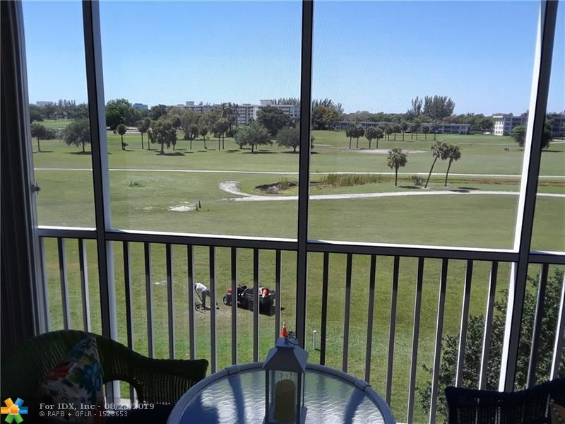 Palm Aire 2/2 with sweeping golf views. This condo offers an updated kitchen with new refrigerator extended cabinets and wine cooler. The Living/Dining room has hurricane shutters for balcony, The second Bedroom has crown molding, hurricane impact window with an updated bathroom. Master bedroom has crown molding, plantation shutters with lots of closet space with organizers in walk-in and an updated bath. The condo is tastefully furnished and very well maintained with newer a/c. Building requires 10% down with 1 year HOA maintenance in escrow for 3 years. Maintenance include water/trash, cable and internet. This buildjng has additional storage, was just painted and 40-yr concrete reconstuction as been completed, Lobby just updated.