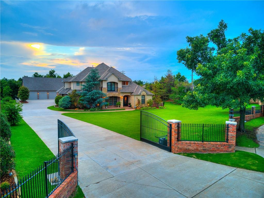 Luxury living in SW OKC!! Gorgeous custom home on over an acre. Monte Cristo front doors compliment the arched architectural detail and iron staircase in the entry. The living room boasts a floor-to-ceiling stone fireplace & hardwood floors. The kitchen has double ovens, gas stove, built-in refrigerator, & large island. Adjacent to the kitchen is a butler's pantry with an ice maker & wine fridge. On the 1st floor there are 2 bedrooms-the primary suite and a guest suite with a  walk-in closet/safe room. Upstairs there are 2 bedrooms, 2 full bathrooms and a media room. The media room has a balcony and wet bar with beverage fridge & microwave. The large covered porch with fireplace & built-in grill is perfect for entertaining by the pool/hot tub! To top it all off is a 30x50 heated shop with epoxied floors. The shop includes a heated & cooled gym/bonus space with half bath.