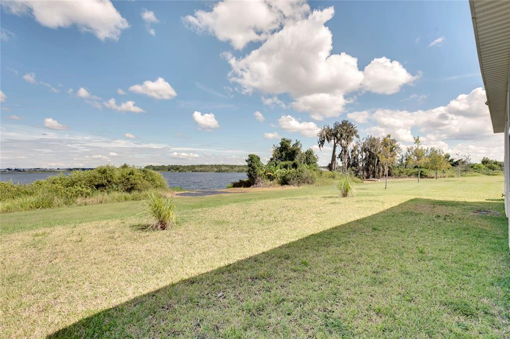 backyard with lake view and conservation area