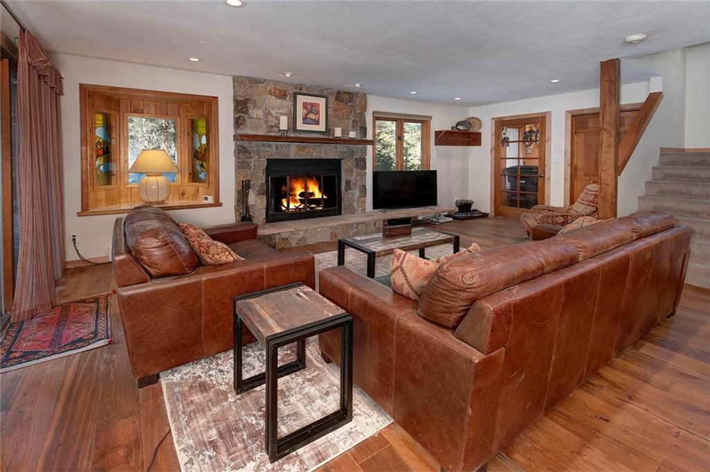 "This quintessential ""cabin in the woods"" has recently been updated throughout. Sunny great room with an oversized dining area. Enjoy the wood-burning fireplace on those wintery evenings while watching the snowfall. The private back yard features a new deck and hot tub. Just minutes for Downton Breckenridge. Plans are included for an addition and a two-car garage."