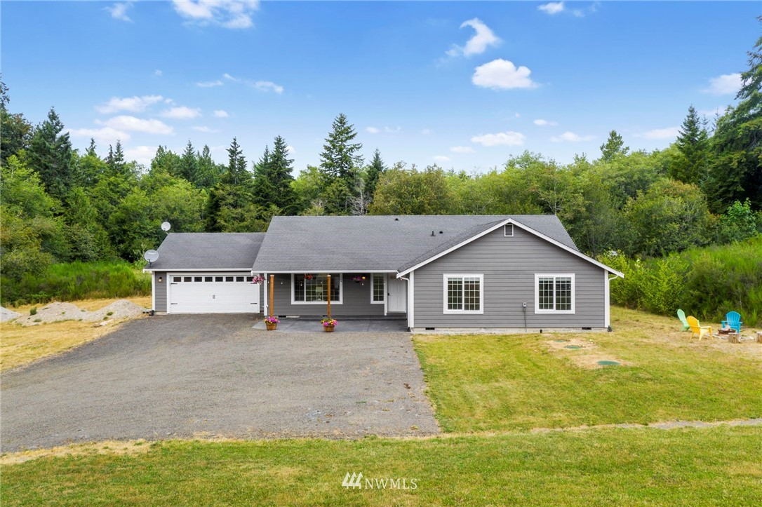 Privately situated on 5 spacious acres, this single story home features a wonderful open floor plan with vaulted ceilings and skylights that make for a bright and inviting space. The open kitchen is an entertainers delight with plenty of cabinetry, pantry, tiered island, and newer appliances. Master bedroom boasts of a large walk-in closet and 5 piece en-suite, not to mention 3 more generously sized bedrooms, a full bathroom and large storage closet just down the hall.