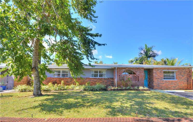 MINUTES TO BEACH, this CLASSIC, WILTON MANORS BUNGALOW has the vibe of a TROPICAL RETREAT!  MOVE-IN READY, home features 3 beds, 2 full baths, PLUS, IN-LAW APT w/ FULL BATH & PRIVATE ENTRY for OFFICE/GUESTS/RENTAL.  Relax around the POOL or the garden deck in the PRIVATE FENCED YARD, surrounded by LUSH PALMS & FL FOLIAGE! Inside, the OPEN, CERAMIC TILED LIVING AREA makes for EZ entertaining. The WINDOW WALLS of the FL ROOM bring the outside greenery in! Recent upgrades: UNDER HOUSE PLUMBING, ELECTRIC PANEL & WIRING, AC (2018), NEW KITCHEN CABINETS, GRANITE COUNTERS, NEW SS APPLIANCES, NEW BATHS w/ glass shower panels & TANKLESS WATER HEATER. LARGE laundry/utility room. Sprinklers use well! Close to Oakland Park Blvd & access to I-95, 20 mins to airport, a popular & convenient location.