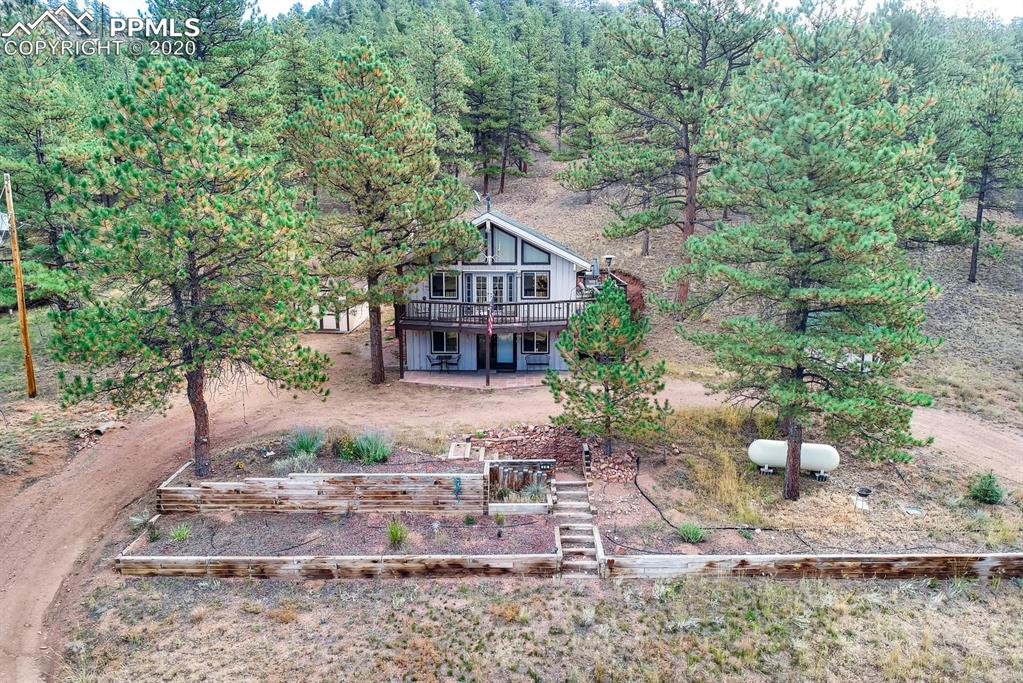 FANTASTIC opportunity to own a recreational property in Sportsman's Paradise! .84 acre lot backing to National Forest! Gated community with views of private community ponds from the home in a gorgeous mountain setting! Private community access to approximately 1.8 miles of the South Platte River and (7) community ponds make for an ideal family get-away and phenomenal fishing opportunities! The home itself features a wrap around deck with unique views from every angle, circular drive, and 2 separate storage sheds!