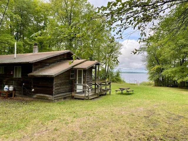 Extremely rare opportunity to own almost 300' of pristine northwest facing shoreline on Sucker Bay of Leech Lake. Gradual sloping elevation to sandy shoreline perfect for safe family swimming and for building the lake home of your dreams. Total privacy on well maintained dead-end road, fiber optic available, gorgeous sunsets, wildlife and one of the finest fishing lakes in the state. 100' dock and 3000# boat lift included. The cabin is seasonal with the value being in the land.