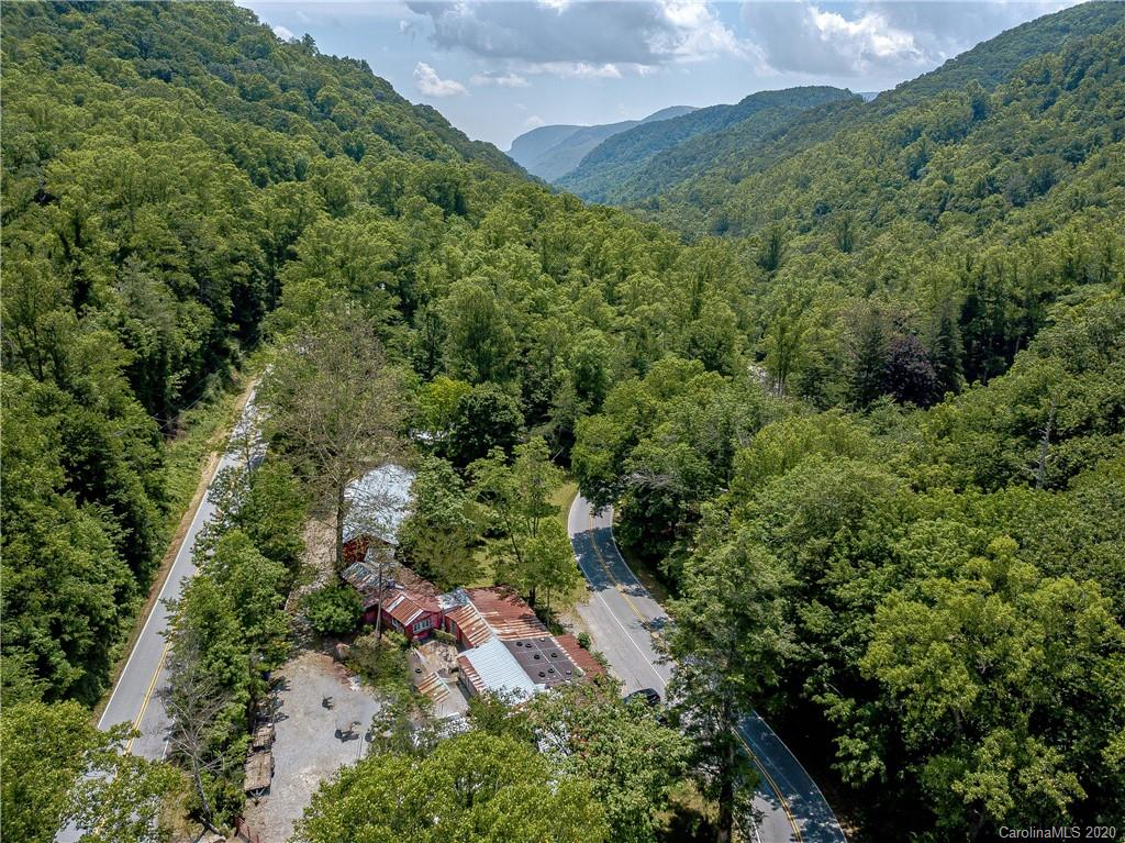 This unique property is the ideal blank canvas for the buyer looking for a live/work space, open to many possibilities ranging from artist studios, gallery space, retail and beyond. Excellent location in the heart of the Hickory Nut Gorge, with frontage on a bustling scenic highway, minutes to Chimney Rock, Lake Lure and less than 30 minutes to Downtown Asheville. Building includes a 1,945 SF workshop with concrete floor, 2 ADA bathrooms, covered porches/decks, several display rooms and storage rooms with over 5,470 SF under roof. 12 Minutes to Chimney Rock, 18 Minutes to Lake Lure, 28 Minutes to Asheville, 30 Minutes to Hendersonville. Also listed as commercial mls#3629397.
