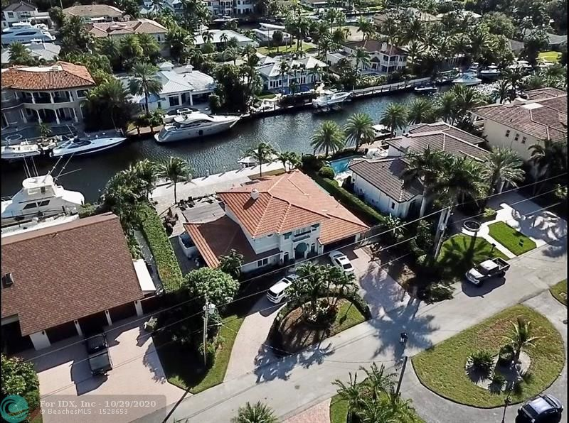 This beautiful deep water home is in the heart of Lighthouse Point. Only minutes from the inlet. Home features a 100 Ft cement dock which includes water, electric and a filet station. Resort style pool area and paver decking invites you to enjoy South Florida living at its best. Beautiful home is perfect for entertaining with wet bar, Sub Zero Refrigerator, Thermador range and lovely fireplace. Travertine and hardwood flooring throughout  