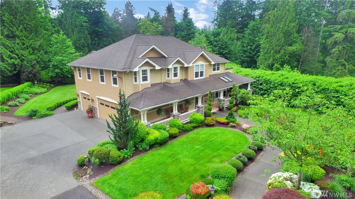 Tucked away along a private drive, discover a home exuding effortless charm, and its grounds an easy grace. Custom designed and built, with high-end specifications: radiant infloor heat, extensive use of hardwood flooring, and elegant cabinetry, millwork, and tilework. Great room design: high ceilings, big windows, facing south in back for exceptional natural light in all seasons. 1.73 acre lot is a gardener's paradise, with expansive lawn, fire pit, and ringed with trees for sublime seclusion.