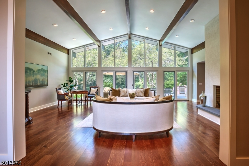 All one level living set on 5+ private acres. This move-in-ready custom home has undergone a recent complete renovation. A gourmet kitchen, new baths, floors, moldings, exterior patio, & lower level are just some of the detailed modernizations.  Each of the 5 bedrooms have private access to a luxurious bathroom with radiant floor heating.  The impressive kitchen has oversized marble top island, leathered granite perimeter, dry bar, & new Wolf/SubZero appliances.  A family room w/ wb fp, dining room, office, 2 powder rooms, LRw/ wb fp & floor to ceiling new windows enhance the first floor. The LL includes wine cellar, bar area, playroom, gym & sauna/relaxation room.  Each of the rooms in the home are beautifully appointed w/high end finishes & fine quality touches. 2 home offices. Pool, spa, outdoor kitchen.