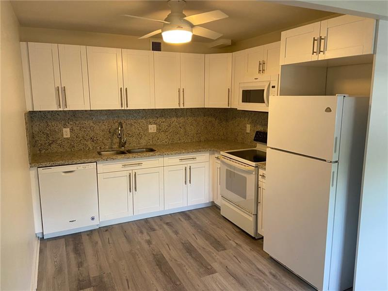 Luxury 2/2(full baths). Ground floor in hi-rise. Brand new renovation thru-out: Kitchen/appliances, floors and so much more. Beautiful park view. Nothing missing. Rent after 1 year. Priced to steal! Literally, steps to newly renovated clubhouse,with every amenity imaginable.  55+community.