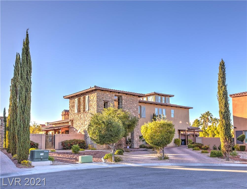 RARE CUSTOM IN PRIVATE GATED ENCLAVE OF ONLY 5 HOMES .42 ACRES TUSCAN DESIGNED FARMHOUSE WITH MULTIPLE BALCONIES, PATIOS, COURTYARDS, AND FIREPLACES! CHEF'S KITCHEN TAKES UP THE ENTIRE WING OF PROPERTY WITH WALK-IN PANTRY, WETBAR WITH WINE FRIDGE, LOADS OF CABINETS, DUAL MASTER WITH BATH, UPSTAIRS LOFT, JACK AND JILL BEDROOM BATH COMBO, PRIVATE MASTER SUITE WITH JACUZZI TUB, WALK IN CLSET WITH BUILT-INS, BALCONY WITH OUT DOOR FIREPLACE, AND 3RD STORY SITTING ROOM WITH STRIP VIEW! SIDE DRIVEWAY WITH 3 CAR OVERSIZED GARAGE! THIS WILL NOT LAST WITH THESE FEATURES, MOST FURNISHINGS INCLUDED IN SALE! BY APPOINTMENT ONLY, PLEASE CALL AGENT FOR SHOWINGS.