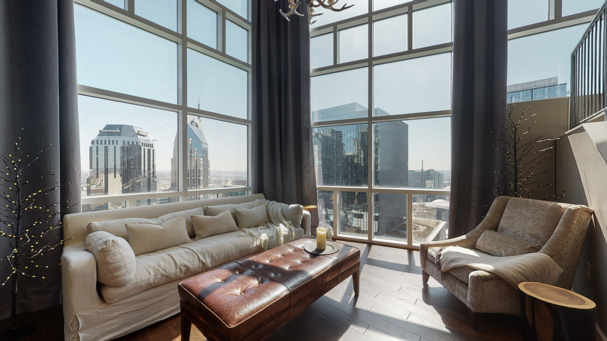 Beautiful 2 story penthouse in the heart of Downtown overlooking Bridgestone Arena. This 3 bedroom, 2 1/2 bath beauty boasts floor to ceiling windows with breathtaking views of the Nashville skyline. First floor media room is optional 4th bedroom with large walk in closet. Walk just blocks to Broadway and the retail of the newly developed 5th and Broad, including the new Apple store. Amenities include Zen courtyard with fire pit, game and billiards hall, state of the art fitness center and more.